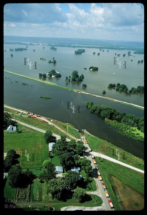 Boat takes last sandbaggrs to inner levee as flood of 93 breaches outer levee;(v)Prairie du Rocher Illinois