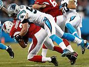 CHARLOTTE, NC - JAN 24:  Linebacker Luke Kuechly #59 of the Carolina Panthers tackles running back David Johnson #31 of the Arizona Cardinals during the NFC Championship game at Bank of America Stadium on January 24, 2016 in Charlotte, North Carolina.
