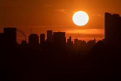 © Licensed to London News Pictures. 17/04/2021. London, UK. The sun sets over the London Skyline. Temperatures are expected to rise with highs of 16 degrees forecasted for parts of London and South East England later this week . Photo credit: George Cracknell Wright/LNP