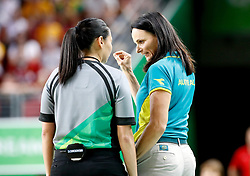 Australia head coach Sandy Brondello (right) speaks with an official after Australia's Elizabeth Cambage (not in picture) is ejected in the Women's Gold Medal Game at the Gold Coast Convention and Exhibition Centre during day ten of the 2018 Commonwealth Games in the Gold Coast, Australia.
