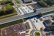 Nederland, Flevoland, Gemeente Dronten, 01-05-2013; NS Station, onderdeel van de Hanzelijn. PR Park and Ride en OV, busstation.<br /> New constructed railway station and bus station  in Dronten, parking system Park and Ride, car drivers park and take the train to their destination.<br /> luchtfoto (toeslag op standard tarieven);<br /> aerial photo (additional fee required);<br /> copyright foto/photo Siebe Swart