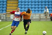Fotball, 21. juli 2004, Treningskamp, Lyn - Wolverhampton, 2-1, Shaun Newton, Wolverhamton, og Mounir Hamoud, Lyn