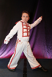 © Licensed to London News Pictures. 07/01/2012. BIRMINGHAM, UK.  Daniel Jenkins (9) practices his 'Elvis act' as he prepares to take part in the annual European Elvis Championship at the Hilton Metropole Hotel at the National Exhibition Centre today.  Photo credit: Alison Baskerville/LNP