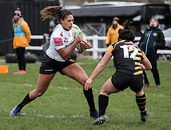 Garnet Mackinder of Exeter Chiefs is challenged by w12,  - Mandatory by-line: Arron Gent/JMP - 06/03/2021 - RUGBY - Twyford Avenue - Acton, England - Wasps FC Ladies v Exeter Chiefs Women - Allianz Premier 15s