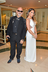 Musician JOHN THEMIS and his daughter KATERINA THEMIS at the 6th annual Asian Awards held at The Grosvenor House Hotel, Park Lane, London on 8th April 2016.