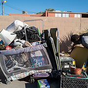 People who were forced out of their homes pack goods into shopping carts in Las Vegas, Nevada on Saturday, October 17, 2020. (Alex Menendez via AP)