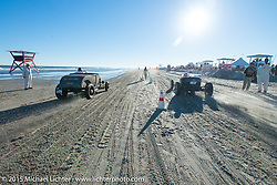 Racing into the afternoon sun at the Race of Gentlemen. Wildwood, NJ, USA. October 11, 2015.  Photography ©2015 Michael Lichter.