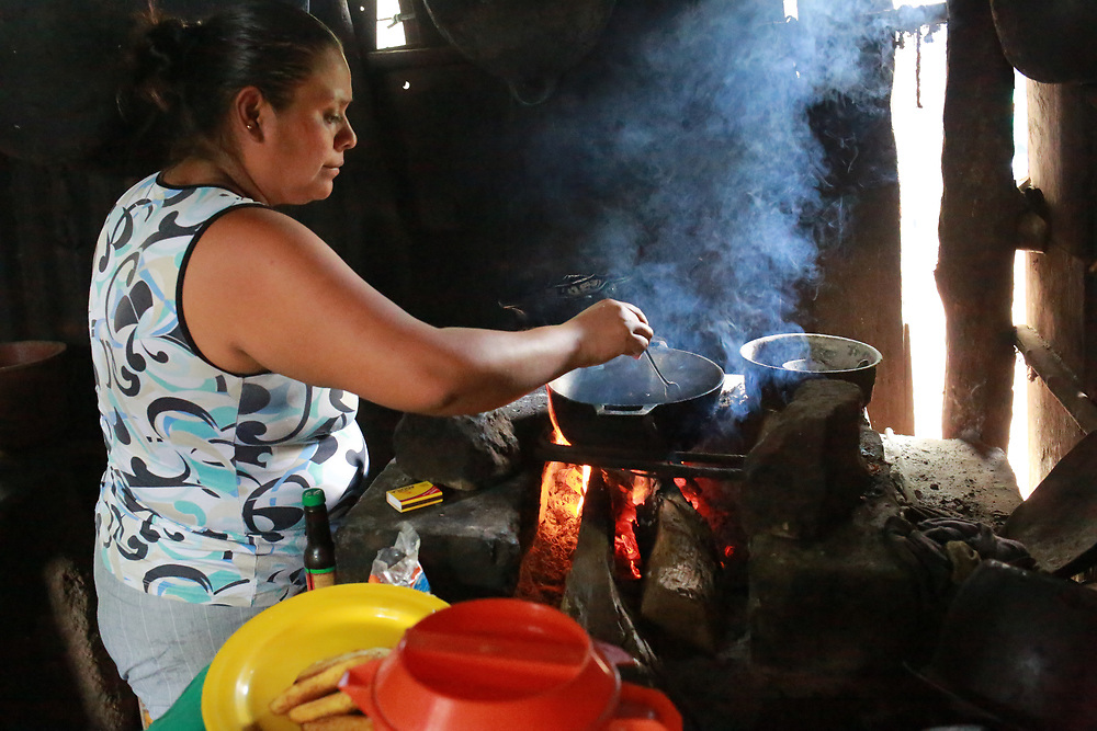 Iris Mercedes Canales cooking at home in El Abra, Carazo, Nicaragua. She says that the family nutrition has improved becuase of the diversification in the CIEETS/CWS program.