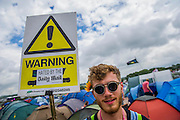 A Green Party member makes his thoughts known. The 2015 Glastonbury Festival, Worthy Farm, Glastonbury.