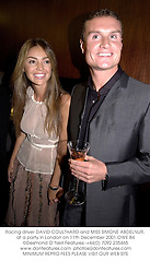 Racing driver DAVID COULTHARD and MISS SIMONE ABDELNUR, at a party in London on 11th December 2001.OWE 84