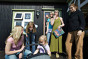 Faith D'Aluisio, right, with the Thoroddson family at home in Hafnarfjordur, near Reykjavik, Iceland. A revisit, after the family was profiled in Material World in 1993. MODEL RELEASED.