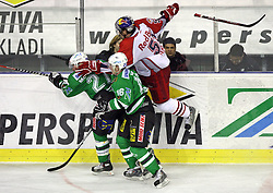 Jeremiah McCarthy, Ales Music and Matthias Trattnig (in the air) at sixth game of the Final of EBEL league (Erste Bank Eishockey Liga) between ZM Olimpija vs EC Red Bull Salzburg,  on March 25, 2008 in Arena Tivoli, Ljubljana, Slovenia. Red Bull Salzburg won the game 3:2 and series 4:2 and became the Champions of EBEL league 2007/2008.  (Photo by Vid Ponikvar / Sportal Images)..