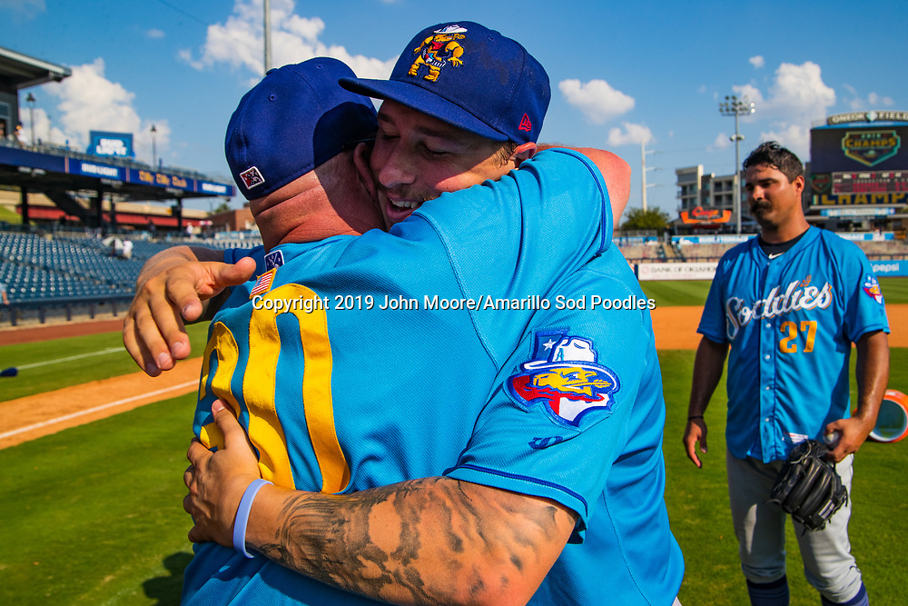 Amarillo Sod Poodles Manager Phillip Wellman and Amarillo Sod Poodles pitcher Lake Bachar (33) celebrates after the Sod Poodles won against the Tulsa Drillers during the Texas League Championship on Sunday, Sept. 15, 2019, at OneOK Field in Tulsa, Oklahoma. [Photo by John Moore/Amarillo Sod Poodles]