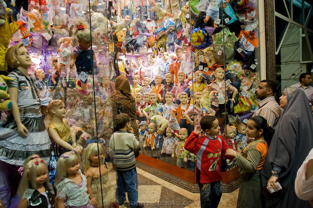 A family looks at dolls in a toy shop in Cairo, Egypt.