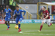 AFC Wimbledon midfielder Tom Soares (19) dribbling away from Northampton Town midfielder John-Joe O'Toole (21) during the EFL Sky Bet League 1 match between AFC Wimbledon and Northampton Town at the Cherry Red Records Stadium, Kingston, England on 10 February 2018. Picture by Matthew Redman.