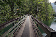 Bridge over Chilliwack River at Chilliwack Lake.  This trail is part of the Trans Canada Trail and is also the start of the Radium Lake Trail up Mount Webb.  Photographed in Chilliwack Lake Provincial Park, British Columbia, Canada.