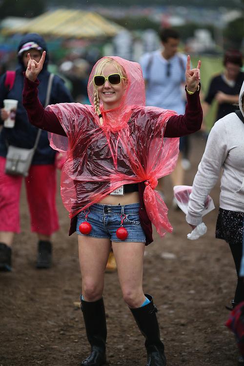 Rain hits revellers at  Glastonbury Festival in Somerset  on Thursday, 27 June 2013