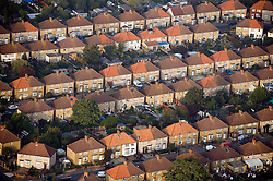 © Licensed to London News Pictures. File pic 31/12/2011. Surrey, UK.  British house prices are rising at their fastest pace in seven years, according to an industry survey. Pictured - An aerial view of properties in Surrey, South East England. Photo credit : Ben Cawthra/LNP