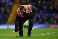 Football - 2018 / 2019 Emirates FA Cup - Fourth Round: Chelsea vs. Sheffield Wednesday<br /> <br /> A steward clears a bottle from the pitch, at Stamford Bridge.<br /> <br /> COLORSPORT/ASHLEY WESTERN