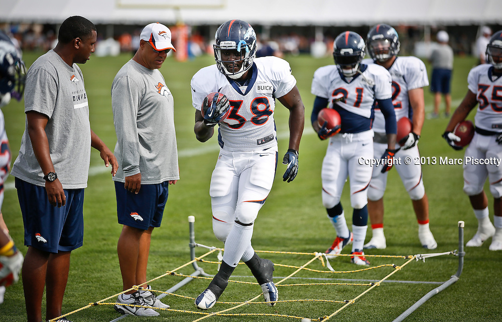 SHOT 8/1/13 9:27:41 AM - Denver Broncos rookie running back Montee Ball #38 runs through drills during the team's training camp August 1, 2013 at Dove Valley in Englewood, Co.  (Photo by Marc Piscotty / © 2013)