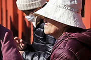 senior Japanese woman with hat over eyes to protect against the strong sunlight