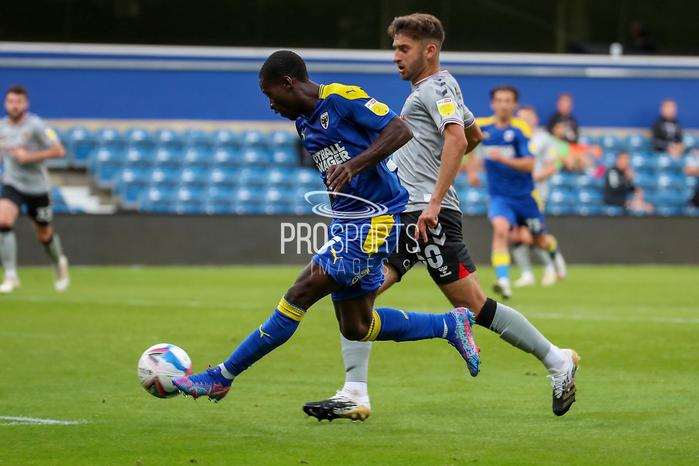 AFC Wimbledon defender Paul Osew (37) dribbling and passing into the box during the EFL Trophy Group O match between AFC Wimbledon and Charlton Athletic at the Kiyan Prince Foundation Stadium, London, England on 1 September 2020.