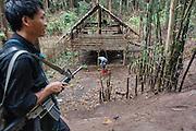 KNLA soldier next to a civilian