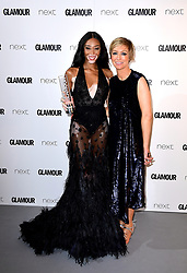 Winnie Harlow (left) receives the Editor's Award from Jo Alvin (right) in the press room at the Glamour Women of the Year Awards 2017, Berkeley Square Gardens, London.