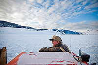 BRADLY J. BONER / NEWS&GUIDE .Grant Gertsch takes in the view on the National Elk Refuge while taking a break from feeding operations on a frosty February morning.