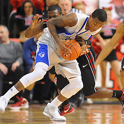 Rutgers Scarlet Knights guard Eli Carter (5) reaches in and fouls Seton Hall Pirates guard/forward Fuquan Edwin (23) during first half Big East NCAA Basketball between the Rutgers Scarlet Knights and Seton Hall Pirates at the Louis Brown Athletic Center. Rutgers leads Seton Hall 28-26 at halftime.