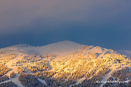 Days last light shines on ski runs of Whitefish Mountain Resort in Whitefish, Montana, USA
