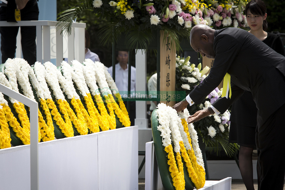 August 9, 2016 - Nagasaki, Nagasaki Prefecture, Japan - NAGASAKI, JAPAN - AUGUST 9 : Members of foreign delegation lays wreath for the atomic bomb victims in front of the Peace Statue in Nagasaki Peace Park, Nagasaki, southern Japan, Tuesday, August 9, 2016. Japan marked the 71st anniversary of the atomic bombing on Nagasaki. On August 9, 1945, during World War II, the United States dropped the second Atomic bomb on Nagasaki city, killing an estimated 40,000 people which ended World War II. (Credit Image: © Richard Atrero De Guzman/NurPhoto via ZUMA Press)