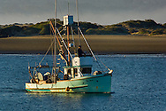 Commercial fishing boat heading out to sea from Morro Bay, California