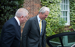 © London News Pictures. 04/07/2012. London, UK. Chairman of Barclays Bank Marcus Agius (right) leaving his home in Chelsea, West London with his driver (left) on July 3, 2012, the day that former CEO of Barclays Bank, Bob Diamond gives evidence to the Treasury Select Committee. Bob Diamond quit his role as Chief Executive of Barclays Bank following an interest rate-setting scandal that led to £290m in fines against the bank. Photo credit: Ben Cawthra/LNP.