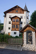 Typical Tyrolean architecture in Leonhard-St Leonardo, a Dolomites village in the Badia region of south Tyrol, Italy. San Leonardo (Sankt Leonhard in German , San Linert in Ladin ) is a tourist Italian , located in the municipality of Badia ( Val Badia , Trentino-Alto Adige ), populated mostly by people who speak the ancient  Ladin language.