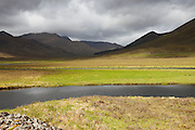 Looking west from the head of Loch Cluanie along Glen Shiel, with the meandering Cluanie River highlighted in the mid and foreground.