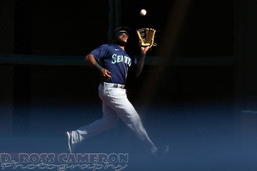 Seattle Mariners right fielder Phillip Ervin (20) makes a running catch of San Francisco Giants' Donovan Solano's fly ball during the ninth inning of a Major League Baseball game, Thursday, Sept. 17, 2020 in San Francisco. The Giants defeated the Mariners 6-4. This is a makeup of a postponed game from Wednesday in Seattle. (AP Photo/D. Ross Cameron)