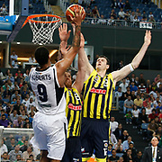 Fenerbahce's Darjus LAVRINOVIC (R) and Oguz SAVAS (C) during their Turkish Basketball Legague Play-Off semi final second match Efes Pilsen between Fenerbahce at the Sinan Erdem Arena in Istanbul Turkey on Friday 27 May 2011. Photo by TURKPIX