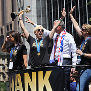 Megan Rapinoe holds the World Cup aloft as The  US Women's Soccer Team float parades Down NYC's 'Canyon of Heroes', Manhattan New York, during their ticker tape parade after winning the FIFA World Championship. A ceremony at City Hall Plaza followed the parade hosted by Mayor Bill de Blasio. Manhattan, New York, USA 10th July 2015. Photo Tim Clayton