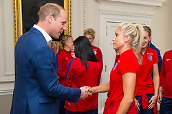 The Duke of Cambridge meets England Women football team captain Steph Houghton during a reception for the England Women football team at Kensington Palace in London.
