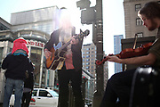 Michael Mac (middle) and Brendan Brown, both of Chicago, members of Shiloh, perform on North Michigan Ave. and East Ontario Street on Friday April 29, 2011.<br /> <br /> (William DeShazer/ Chicago Tribune) B581237233Z.1<br /> ....OUTSIDE TRIBUNE CO.- NO MAGS,  NO SALES, NO INTERNET, NO TV, NEW YORK TIMES OUT, CHICAGO OUT, NO DIGITAL MANIPULATION...