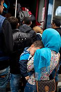 Hungary, Budapest, Keleti Station. Refugees board  a trains to the  Austrian border, including a young mother holding a sleeping child.