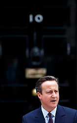 © Licensed to London News Pictures. 08/05/2015. LONDON, UK. Prime Minister and Conservatives leader David Cameron reading a statement after returning to Downing Street after a visit to the Queen and obtaining a formal permission to form a Conservative majority government on Friday, 8 May 2015 following the 2015 General Election in the UK. Photo credit : Tolga Akmen/LNP