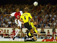 Photograph: Scott Heavey.<br />Arsenal v Aston Villa. FA Barclaycard Premiership match. 27/08/2003.<br />Thierry Henry lobs Thomas sorensen but shaves the outside of the Villa post.