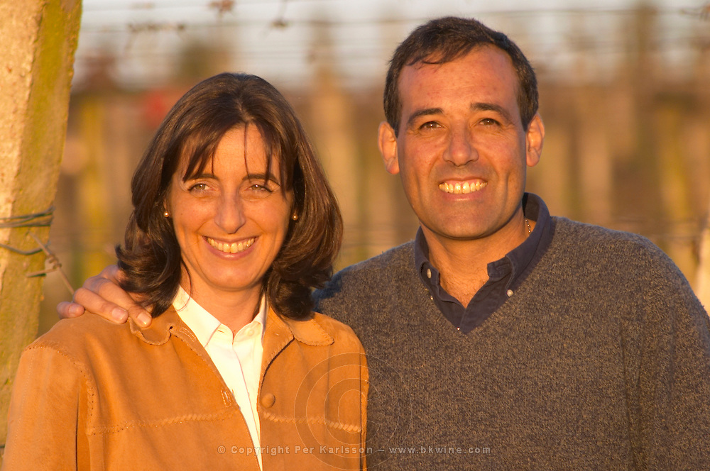 Carlos A Pizzorno and Ana Pizzorno, owners, in front of the vines in the vineyard. Bodega Carlos Pizzorno Winery, Canelon Chico, Canelones, Uruguay, South America