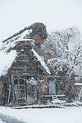 Old ruined cottage covered in snow, Shirakawa-go, Japan