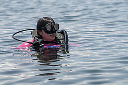March 30, 2019 - Sorowako, South Sulawesi, Indonesia - Sorowako, Luwu Timur, Indonesia (March 30): Deputy Chief Executive Officer of PT. Vale Indonesia Febriany Eddy joined in diving to pick up trash which polluted the Lake Matano tourist area, East Luwu, South Sulawesi, Indonesia, Saturday, March 30, 2019. Movement to clean up initiated by PT. Vale Indonesia - a nickel producer company to maintain the beauty of the deepest lake in Southeast Asia while increasing the number of tourist visits. (Credit Image: © Basri Marzuki/NurPhoto via ZUMA Press)