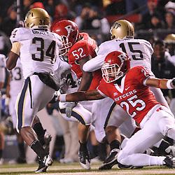 Oct 16, 2009; Piscataway, NJ, USA; Pittsburgh running back Ray Graham (34) dodges a tackle by Rutgers cornerback Brandon Jones (25) during first half NCAA football action between Rutgers and Pittsburgh at Rutgers Stadium.
