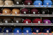 The iconic NY Yankees hats are everywhere in Harlem as can be seen here inside one of the many shops in the hug of Harlem.  Harlem, a neighborhood of New York City in Manhattan, began as a Dutch village in 1658 and was later annexed to New York City in 1873.  At the beginning of the 20th century African-American's began arriving from the southern American states looking for work in the more industrious north.  With their migration, the African-American community brought with them a renaissance in the arts to Harlem that is still evident today.  After World War II Harlem began experiencing a significant rise in crime and poverty due to the Great Depression that lasted until the 21st century.  A new pride in the community has brought a renewed revival to Harlem, and crime rates have dropped to record lows giving the New York City neighborhood a new lease on life.