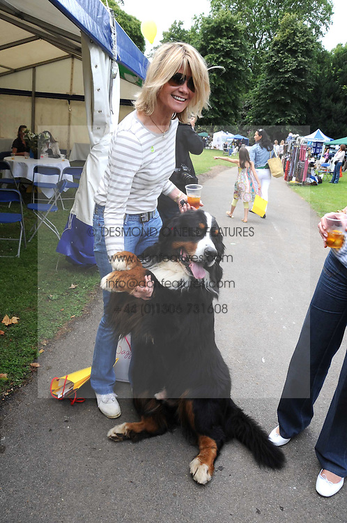 LADY CHARLOTTE DINAN with her dog Bilko at the Macmillan Dog Day in aid of Macmillan Cancer Support held at the Royal Hospital Chelsea, London on 8th July 2008.<br /><br />NON EXCLUSIVE - WORLD RIGHTS